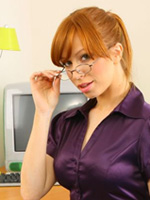 Redheaded Secretary Alex Wearing Sexy Glasses Works Her Tight Body Around The Office