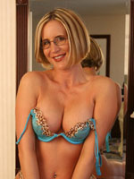 Desire Spencer Is A Busty Blonde MILF Wearing Glasses In Sexy Lingerie Stripping Off Her Leopard Print Panties